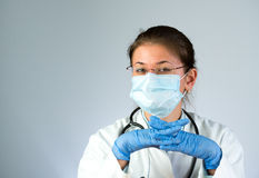 Doctor wearing mask Stock Images