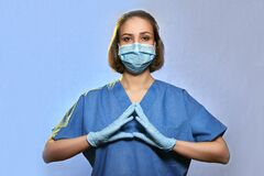 Doctor wearing medical uniform protective mask and gloves , Coronavirus Epidemic COVID-19