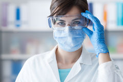 Doctor wearing protective glasses Stock Photo