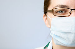 Doctor wearing protective mask Stock Photos