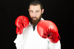 Doctor wearing red boxing gloves Royalty Free Stock Photos