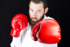 Doctor wearing red boxing gloves. Royalty Free Stock Photos