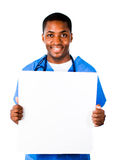 Doctor wearing scrubs and holding a white card Stock Image
