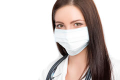 Doctor wearing surgical mask Stock Photography