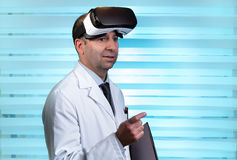 Doctor wearing virtual reality glasses in clinical consultation royalty free stock photo