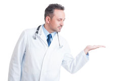 Doctor wearing white robe holding nothing on palm Stock Photography