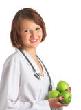 Doctor on white. Doctor with apples in her hands Stock Image