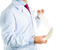 Doctor in white coat bandaging a banana Royalty Free Stock Photos
