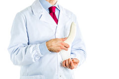 Doctor in white coat bandaging a banana Stock Photography