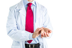 Doctor in white coat feeling his pulse Royalty Free Stock Photo