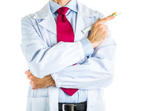 Doctor in white coat holding syringe full of pills Royalty Free Stock Photography