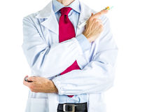 Doctor in white coat holding syringe full of pills Stock Photos