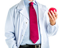 Doctor in white coat showing a red apple Royalty Free Stock Image