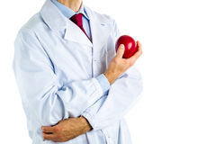 Doctor in white coat showing a red apple Royalty Free Stock Photos