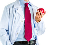Doctor in white coat showing a red apple Royalty Free Stock Images