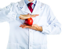 Doctor in white coat showing a red apple Stock Photography