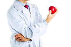 Doctor in white coat showing a red apple Stock Image