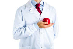 Doctor in white coat showing a red apple Stock Photos