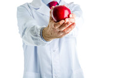 Doctor in white coat showing a red apple Stock Photo