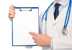 The doctor in a white coat with a stethoscope holding a folder w Stock Image