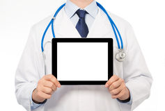 The doctor in a white coat with a stethoscope holding tablet wit Royalty Free Stock Photography
