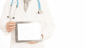 Doctor in white coat with stethoscope showing blank digital tablet pc Isolated on white.  Royalty Free Stock Images