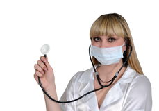 The doctor in a white dressing gown with a stethoscope Stock Photos