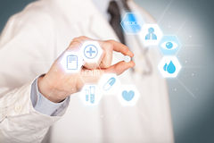 A doctor in white holding a pill Royalty Free Stock Images