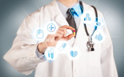 A doctor in white holding a pill Stock Photo