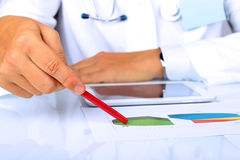 Doctor  in a white labcoat showing something on a graphs Stock Images