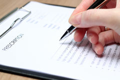 Doctor  in a white labcoat writing out RX prescription Royalty Free Stock Images