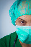 Doctor wiith surgical mask and cap Stock Image