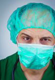 Doctor wiith surgical mask and cap Royalty Free Stock Image