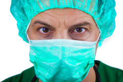 Doctor wiith surgical mask and cap Royalty Free Stock Photo