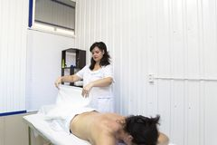 The doctor wipes the patient`s back. royalty free stock image