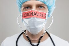 Free Doctor With A Respiratory Mask Fighting The Deadly Coronavirus Covid-19 Epidemic Royalty Free Stock Photo - 174964855