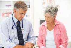 Doctor With Female Patient Stock Photos