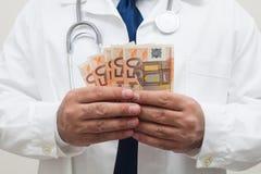 Doctor With Money In Studio Stock Image