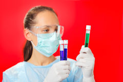 Doctor (woman) analyzing medical test tubes Royalty Free Stock Image