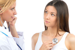 Doctor woman auscultating young patient stock images