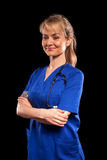 Doctor woman in blue labcoat Stock Images