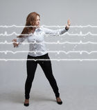Doctor woman and cardiogram lines. Young doctor woman and cardiogram lines in air Royalty Free Stock Photography