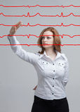 Doctor woman and cardiogram lines. Young doctor woman and cardiogram lines in air Stock Photos