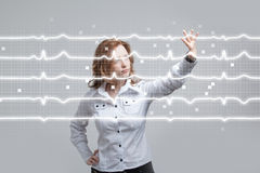 Doctor woman and cardiogram lines. Young doctor woman and cardiogram lines in air Stock Image