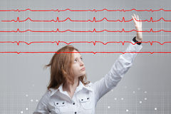 Doctor woman and cardiogram lines. Young doctor woman and cardiogram lines in air Royalty Free Stock Photos