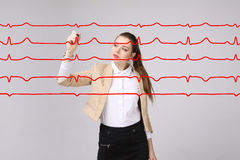 Doctor woman and cardiogram lines. Young doctor woman and cardiogram lines in air Stock Images