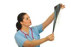 Doctor woman checking x-ray Stock Photos