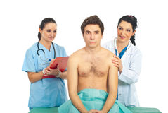 Doctor woman checkup male patient Stock Photo