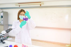 Doctor woman or chemist working with  microscope Stock Images