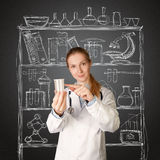 Doctor woman with cup for analysis Stock Images